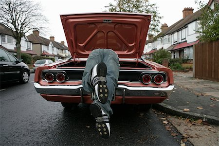 Man Looking through Trunk of American Car on English Street Stock Photo - Rights-Managed, Code: 700-01463900
