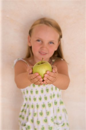 Child Holding Apple Stock Photo - Rights-Managed, Code: 700-01538790
