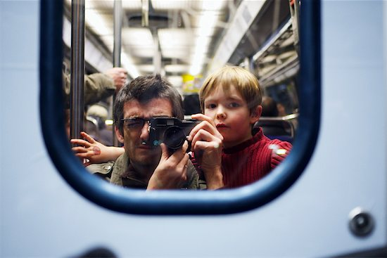 Man Taking Picture of Self and Son in Subway Mirror Stock Photo - Premium Rights-Managed, Artist: oliv, Image code: 700-01541074