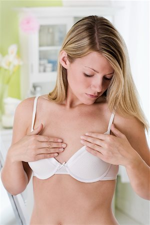 Woman Adjusting Bra Stock Photo - Rights-Managed, Code: 700-01574776