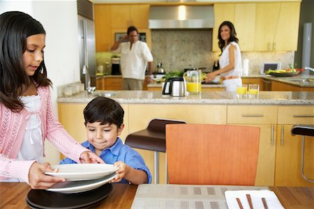 setting kitchen table - Family Setting Table Stock Photo - Rights-Managed, Code: 700-01579448