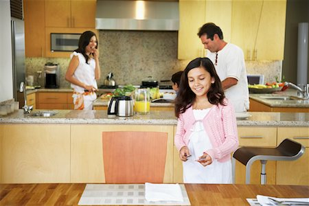 setting kitchen table - Daughter Setting Table Stock Photo - Rights-Managed, Code: 700-01579449