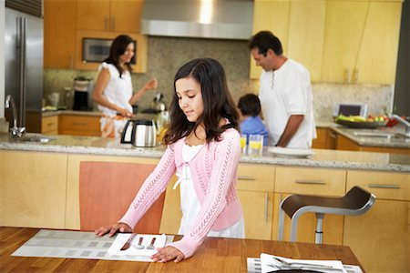 setting kitchen table - Daughter Setting Table Stock Photo - Rights-Managed, Code: 700-01579450