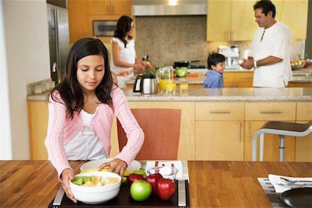 setting kitchen table - Daughter Setting Table Stock Photo - Rights-Managed, Code: 700-01579451