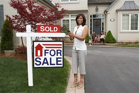 sold sign - Real Estate Agent by House with Sold Sign Stock Photo - Rights-Managed, Code: 700-01571964