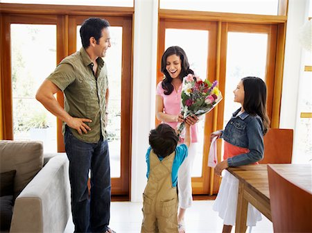 Family Giving Mother Flowers Stock Photo - Rights-Managed, Code: 700-01572065