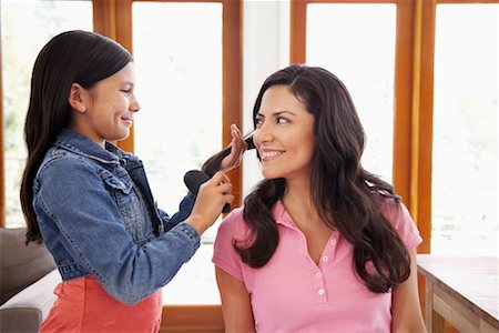 Daughter Brushing Mother's Hair Stock Photo - Rights-Managed, Code: 700-01572099