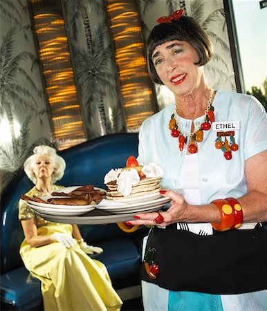 desert people dress photos - Waitress Serving Food to Woman Stock Photo - Rights-Managed, Code: 700-01585944