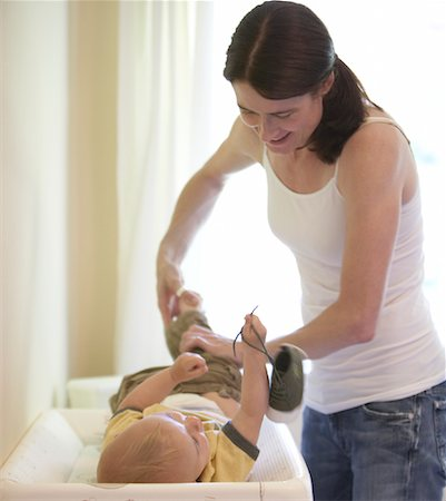 Mother Changing Son's Diaper Stock Photo - Rights-Managed, Code: 700-01586998