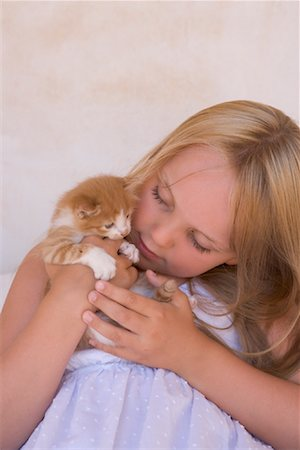 preteen girl pussy - Girl Holding Kitten Stock Photo - Rights-Managed, Code: 700-01587343