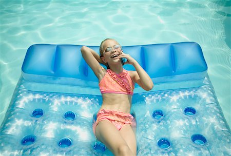Girl Relaxing in Swimming Pool Stock Photo - Rights-Managed, Code: 700-01581899