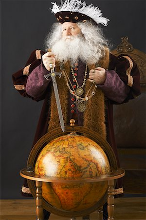 King Standing by Globe Stock Photo - Rights-Managed, Code: 700-01582203