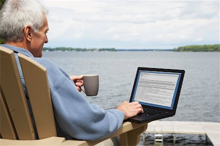 Man at the Cottage, Using Laptop Computer Stock Photo - Rights-Managed, Code: 700-01615218
