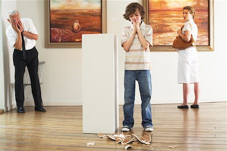 Child Breaking Art in Gallery Stock Photo - Rights-Managed, Code: 700-01639956