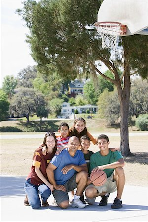 preteen thong - Portrait of Family on Basketball Court Stock Photo - Rights-Managed, Code: 700-01633024