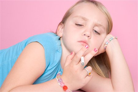 Girl Smoking Cigarette Stock Photo - Rights-Managed, Code: 700-01633211