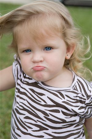 Portrait of Angry Little Girl Stock Photo - Rights-Managed, Code: 700-01646145