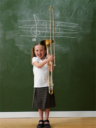Girl in Classroom with Trombone Stock Photo - Rights-Managed, Code: 700-01646366