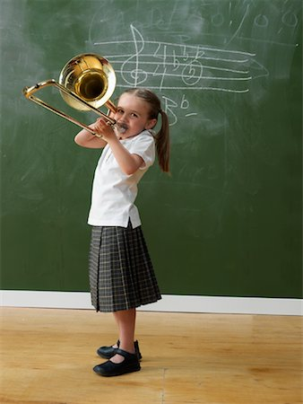Girl in Classroom with Trombone Stock Photo - Rights-Managed, Code: 700-01646367