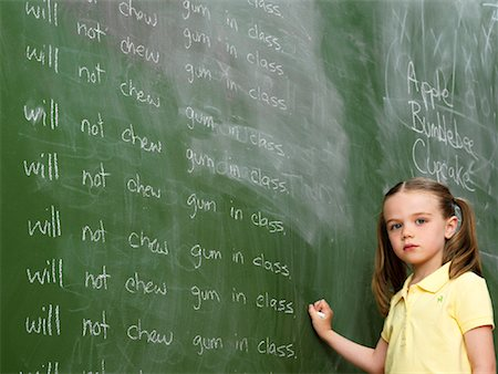 Girl Writing Lines on Chalkboard Stock Photo - Rights-Managed, Code: 700-01646374
