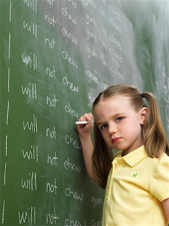 Girl Writing Lines on Chalkboard Stock Photo - Rights-Managed, Code: 700-01646375