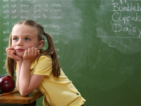 Girl Daydreaming in Classroom Stock Photo - Rights-Managed, Code: 700-01646376
