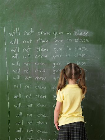 Girl Writing Lines on Chalkboard Stock Photo - Rights-Managed, Code: 700-01646373