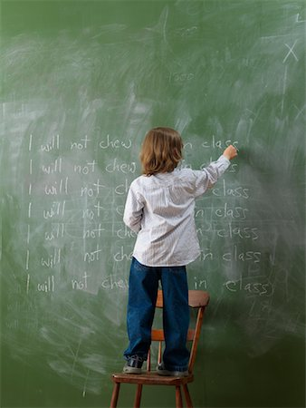 Boy Writing Lines on Chalkboard Stock Photo - Rights-Managed, Code: 700-01646386