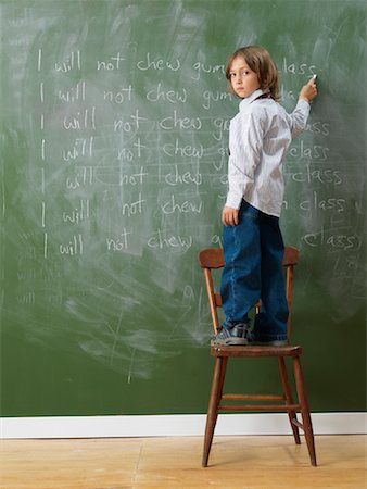 Boy Writing Lines on Chalkboard Stock Photo - Rights-Managed, Code: 700-01646387