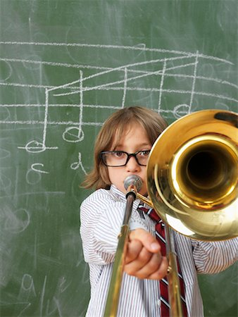 Boy Playing Trombone in Classroom Stock Photo - Rights-Managed, Code: 700-01646388