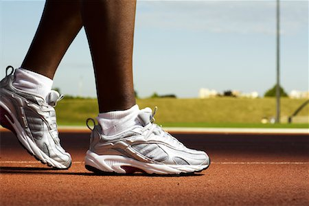 Close-Up of Track Runner's Feet Stock Photo - Rights-Managed, Code: 700-01694324
