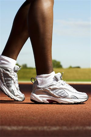 Close-Up of Track Runner's Feet Stock Photo - Rights-Managed, Code: 700-01694325