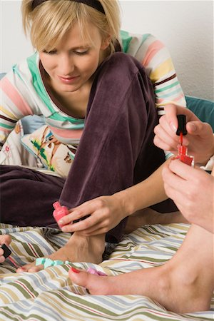Friends Painting Nails Stock Photo - Rights-Managed, Code: 700-01694598