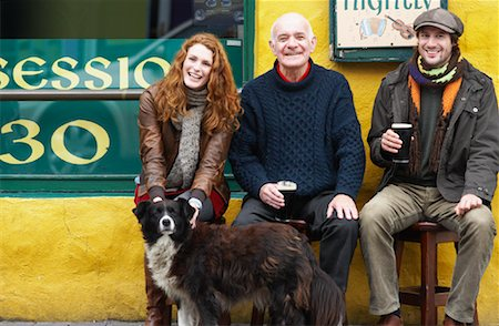 Couple and Man by Pub with Dog, Ireland Stock Photo - Rights-Managed, Code: 700-01694910