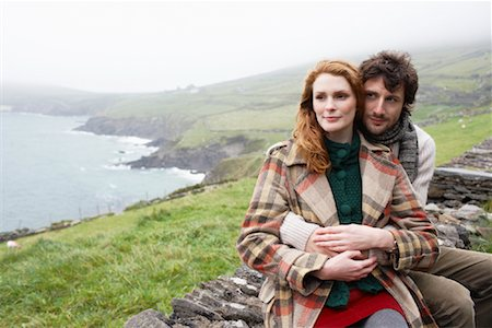 Couple Sitting on Stone Wall, Ireland Stock Photo - Rights-Managed, Code: 700-01694927