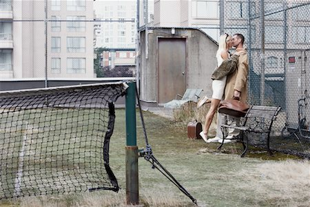 sexually aroused woman - Couple on Tennis Court Stock Photo - Rights-Managed, Code: 700-01695226