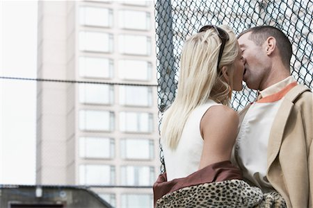 sexually aroused woman - Couple Leaning Against Fence Kissing Stock Photo - Rights-Managed, Code: 700-01695228