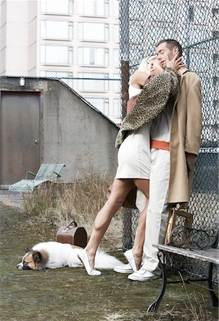 dog kissing man - Couple Leaning Against Fence Stock Photo - Rights-Managed, Code: 700-01695231