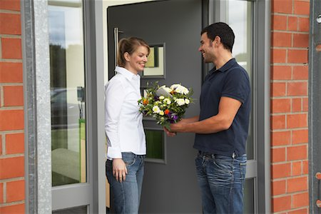 Man Giving Flowers to Woman Stock Photo - Rights-Managed, Code: 700-01716495