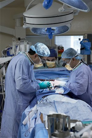Doctors Performing Open Heart Surgery Stock Photo - Rights-Managed, Code: 700-01716538