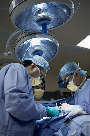 Doctors Performing Open Heart Surgery Stock Photo - Rights-Managed, Code: 700-01716541
