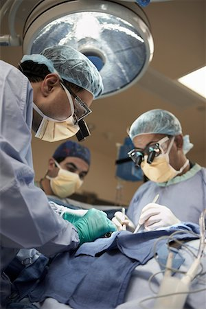 Doctors Performing Open Heart Surgery Stock Photo - Rights-Managed, Code: 700-01716543