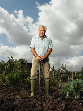 Portrait of Mature Man Standing in Garden Stock Photo - Rights-Managed, Code: 700-01718040