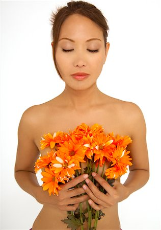 Portrait of Woman Holding Flowers Stock Photo - Rights-Managed, Code: 700-01755621