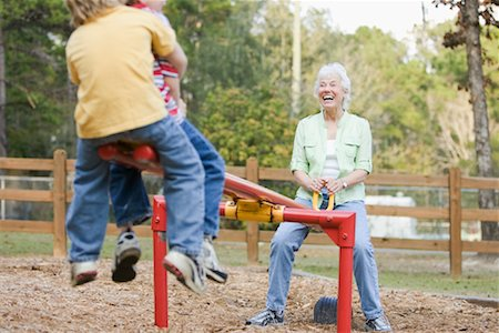 Woman on Teeter-Totter with Grandsons Stock Photo - Rights-Managed, Code: 700-01753617