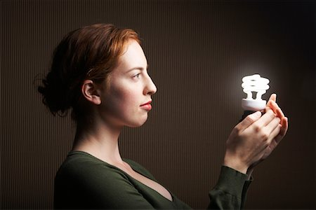Woman Holding Energy Efficient Light Bulb Stock Photo - Rights-Managed, Code: 700-01764271