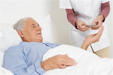 Nurse Giving Medication to Patient Stock Photo - Rights-Managed, Code: 700-01764484