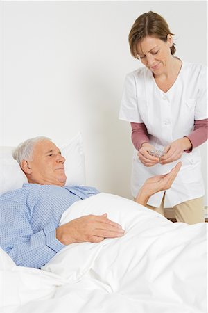 Nurse Giving Medication to Patient Stock Photo - Rights-Managed, Code: 700-01764485