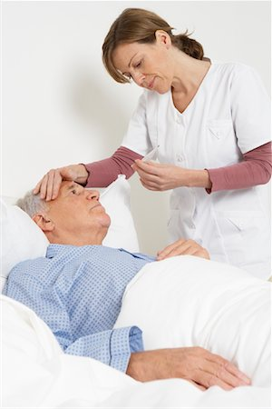 Nurse Taking Patient's Temperature Stock Photo - Rights-Managed, Code: 700-01764482