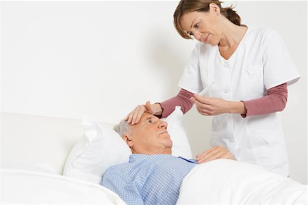 Nurse Taking Patient's Temperature Stock Photo - Rights-Managed, Code: 700-01764483